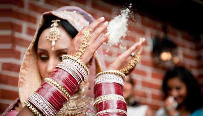 throwing rice at weddings indian