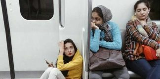 delhi metro people sitting on floor