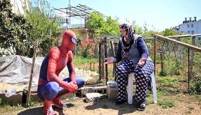 man dresses up as spider man helps neighbours