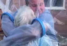 man creates cuddle curtain to hug his grandma during covid 19