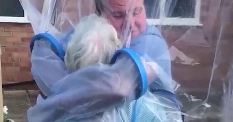 man creates cuddle curtain to hug his grandma during covid 19