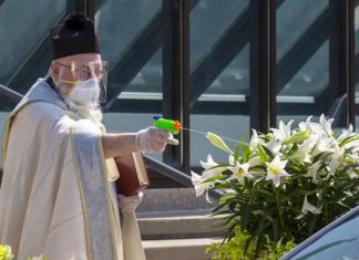 us priest sprays holy water from toy gun