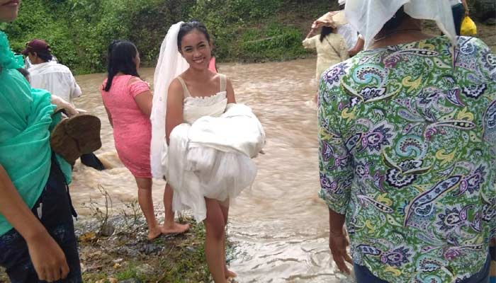 Philippines Wedding Couple Walking Through River
