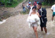 Wedding Couple Walking Through A Flooded
