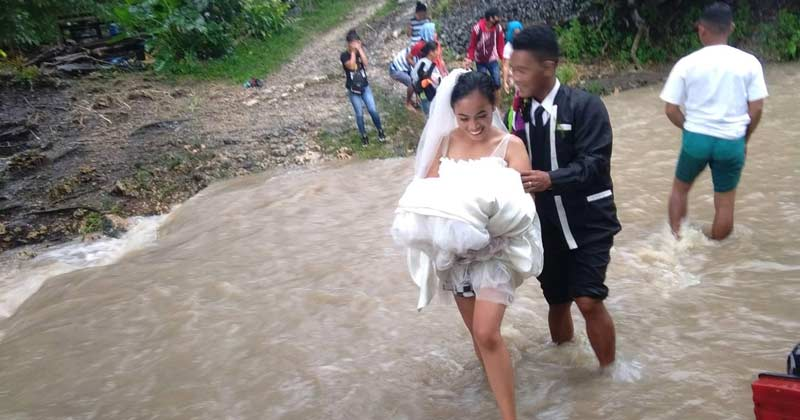 Wedding Couple Walking Through A Flooded