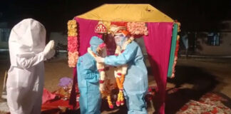 Couple Gets Married In PPE Kits